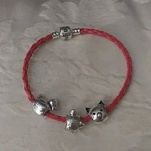Red braided charm bracelet with charms